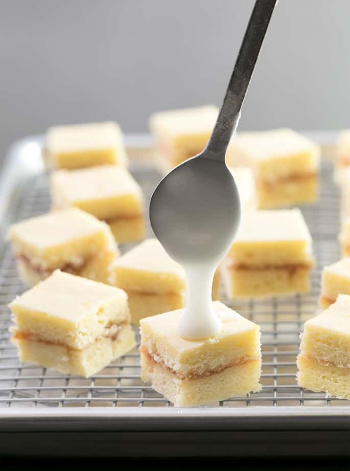 These delicate little petit fours are just tiny iced almond cakes, covered with asimple icing. If you've ever wondered how petit fours are made, or just what that icing is made of, this recipe is for you!