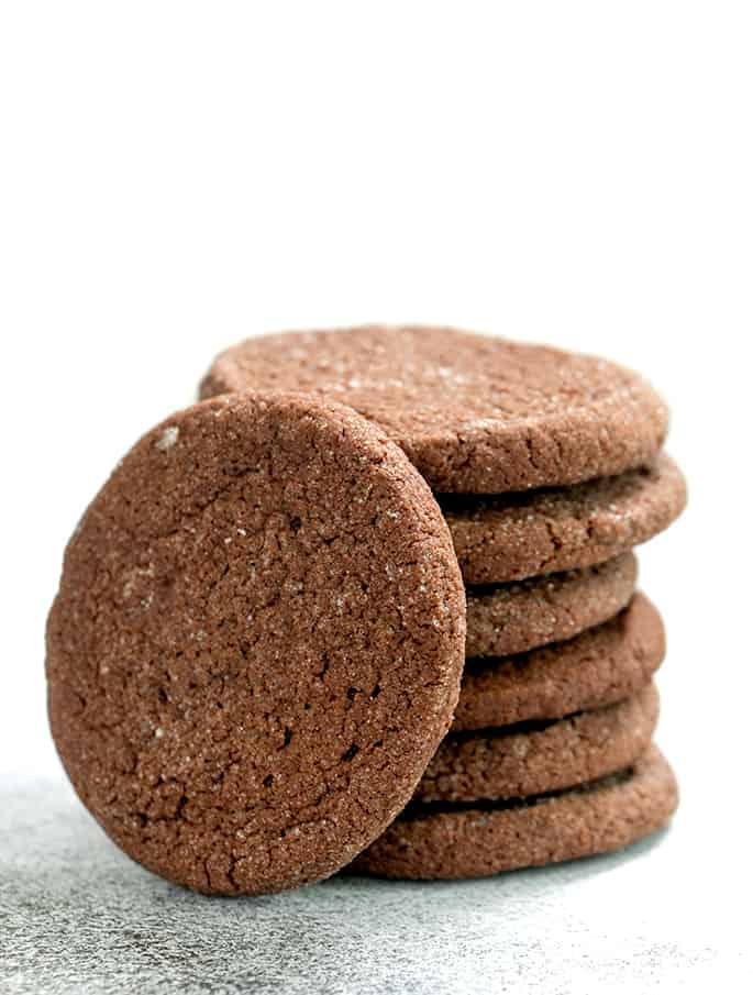 Soft brownie cookies with sugar coating in stack with one on its side