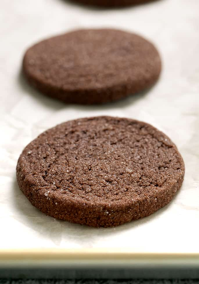 baked brownie cookie with sugar coating on white paper on tray