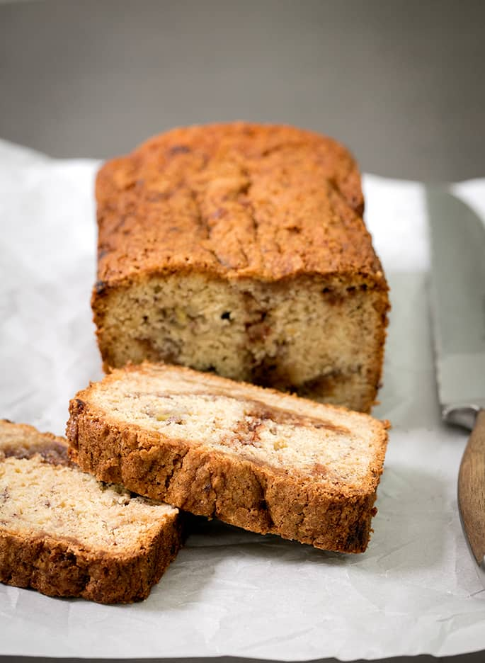 This cinnamon swirl gluten free banana bread is naturally dairy free—and it's incredibly moist and tender. The cinnamon-sugar just seals the deal. It's going to become your new favorite way to save those dying bananas!