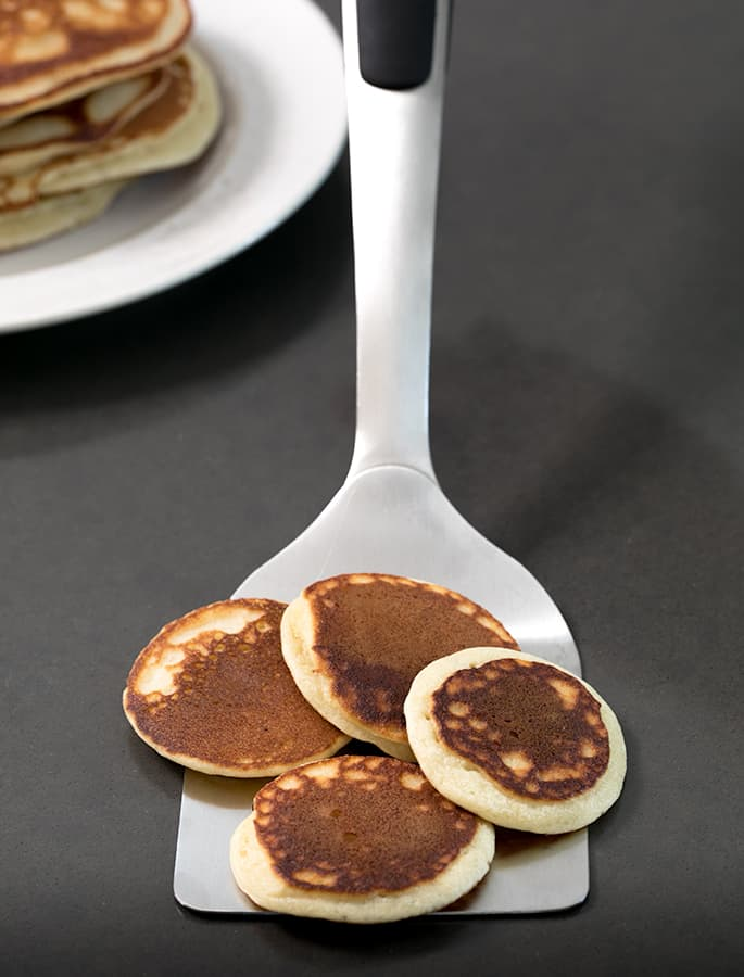 """These lightly sweet Paleo pancakes are made with almond flour, so they're naturally low carb and actually taste like """"real"""" pancakes. Enjoy them with maple syrup, or plain. And make your own Paleo baking powder easily for fluffy pancakes!"""