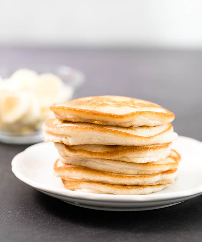 This gluten free vegan pancakes recipe makes super fluffy eggless pancakes in one bowl, in just minutes. Even if you're a vegan, you can still enjoy pancakes!