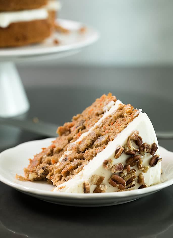 A slice of carrot cake on a small plate