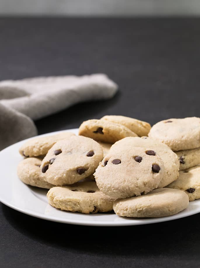 These almond flour cookies are low carb and naturally sweetened and taste like buttery shortbread, but without any butter at all. Make them with chocolate chips or your favorite mix-in.