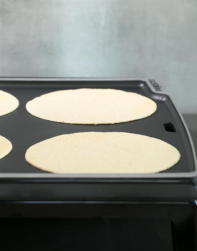 These low carb tortillas are made with a blend of almond flour and coconut flour, and the dough is amazingly easy to handle. With less than 2 net carbs per tortilla, they're going to be your new favorite gluten free tortilla!