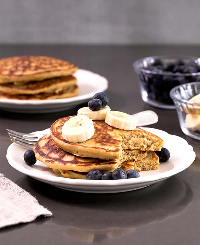 These lower fat, healthy protein pancakes are made without any refined sugars or grains, and without any bananas. The perfect way to start the day!