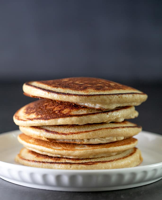 Protein pancakes in a stack on a small plate