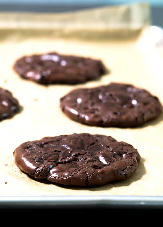 These easy flourless fudge cookies are made with egg whites, sugar, cocoa powder and chocolate chips.Crisp on the edges, and chewy inside. Packed with chocolate flavor!