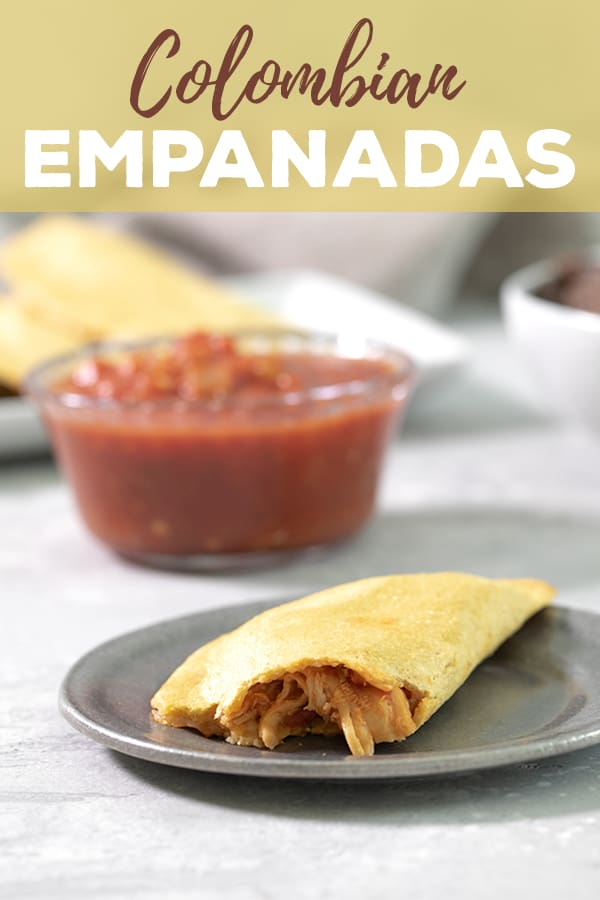 These easy Colombian empanadas are made with just a few simple ingredients and are naturally gluten free. Fill them with shredded chicken like my 2-ingredient Instant Pot chicken, or really anything you like. #naturallygf #gf #glutenfree #empanadas #dairyfree #shreddedchicken #instantpot