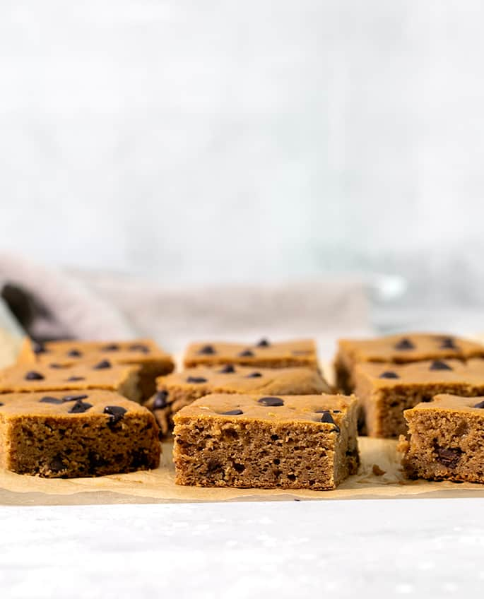 These flourless peanut butter brownies are made with white beans and peanut butter, and just like black bean brownies, they don't taste at all like beans. Really! They don't even have any added oil or butter.