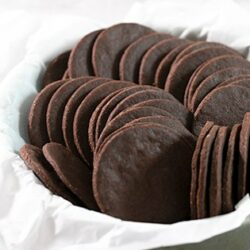 Thin and crispy gluten free chocolate wafer cookies are rich and chocolatey and perfect for making all sorts of no-bake warm weather treats, from icebox cakes to cookie crusts. Stock up for summer!