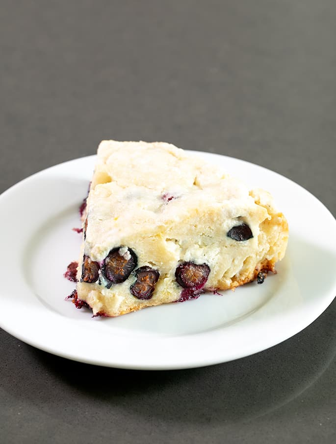 These gluten free blueberry scones are tender and flaky inside, with a lightly crisp top. They can easily be made vegan, too.