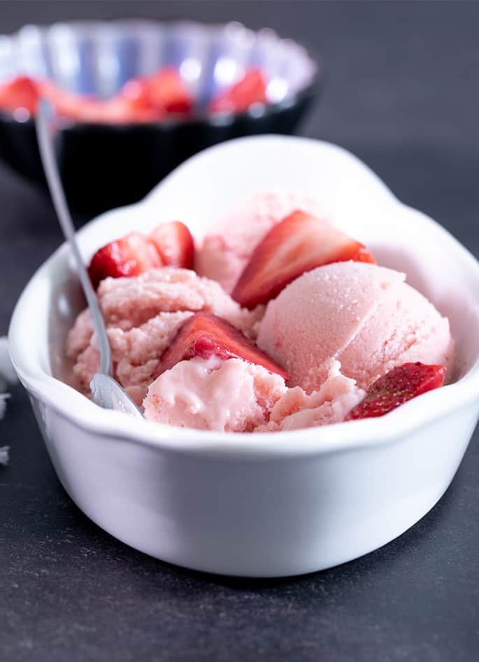 If you've ever wondered how to make frozen yogurt at home (can you just freeze Greek yogurt in an ice cream machine?) this recipe is for you!