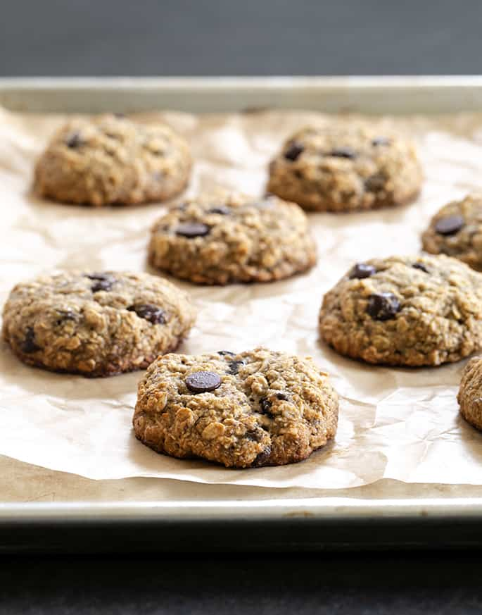 These whole grain banana oatmeal cookies are soft and chewy, sweetened only with bananas and honey and a few chocolate chips. The perfect grab and go breakfast for busy mornings!