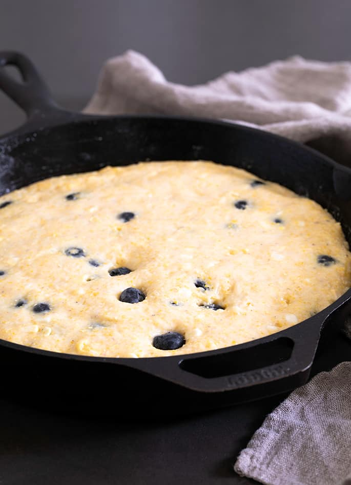 This recipe for gluten free blueberry cornbread is a lightly sweet, naturally dairy-free take on a classic cornbread recipe. It's perfect for potlucks and barbecues, or even for breakfast!