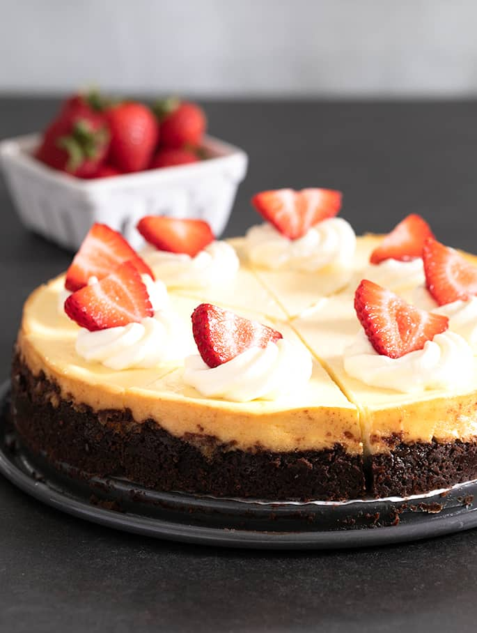 This easy classic gluten free cheesecake is made simply with cream cheese, sugar,and eggs. With or without a graham cracker crust.