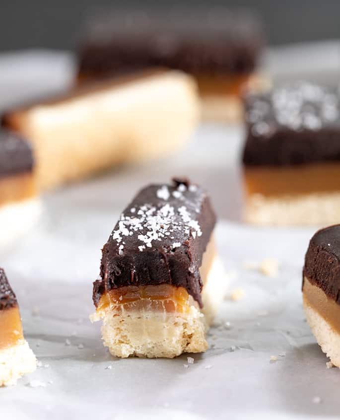 Take simple shortbread to a new level with a simple microwave caramel layer and a chocolate ganache top. These chocolate caramel squares are a showstopper!