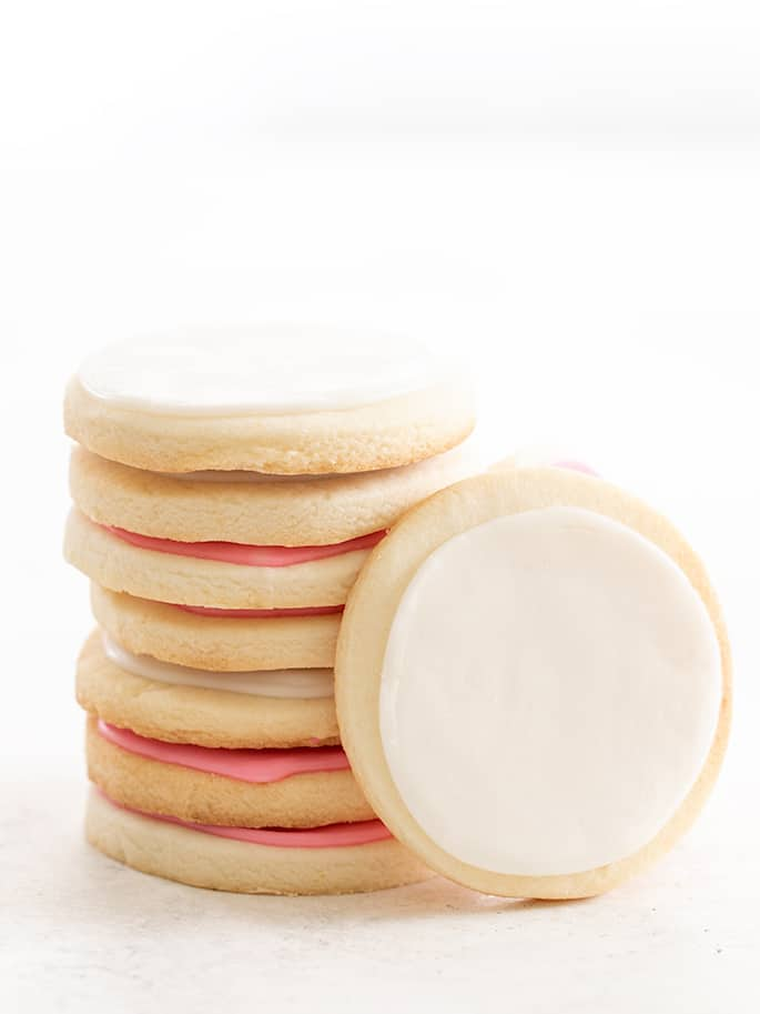 Meltaway cutout cookies in a stack with one on its side