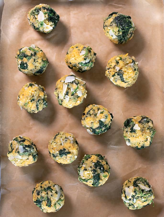 These spinach balls are a simple old-fashioned appetizer easily made gluten free with ordinary pantry ingredients. Little bitesof cheesy good nostalgia.
