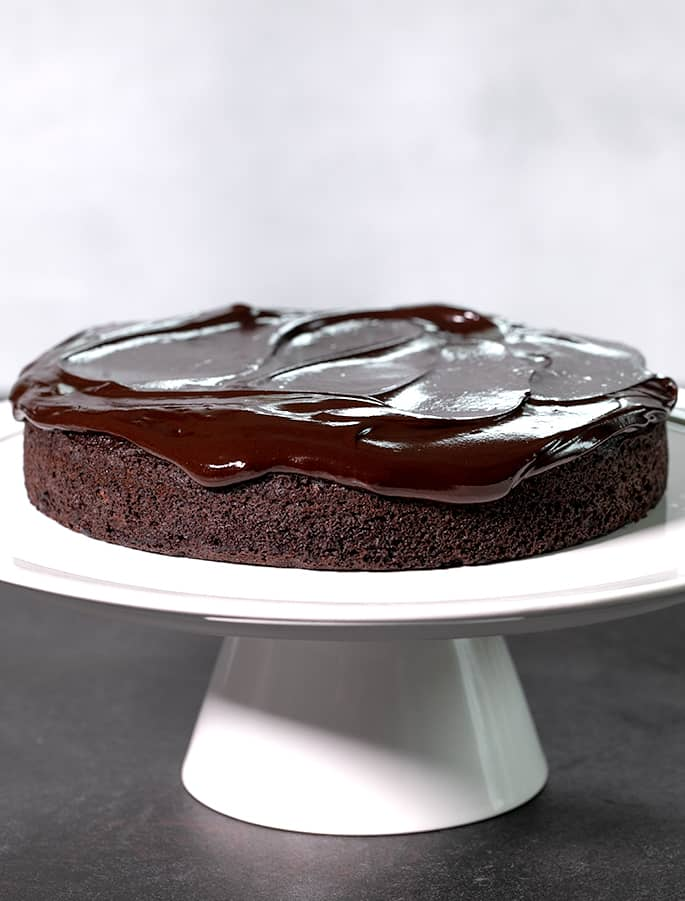 This crazy cake is a gluten free chocolate cake made with no eggs, no butter and no chopped chocolate—but it's still super moist and tender.
