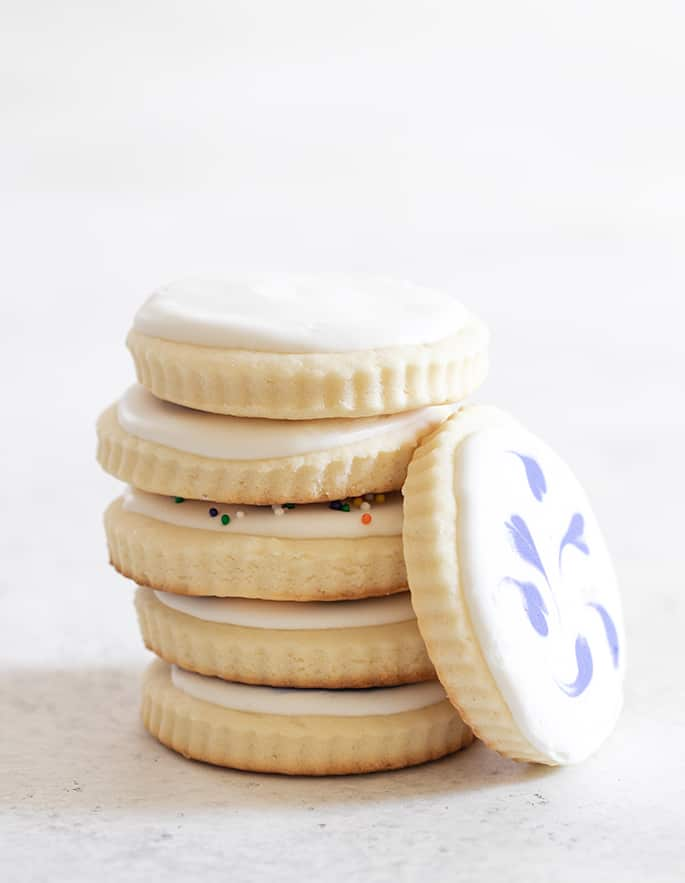 Cream cheese sugar cookies with icing in a tall stack