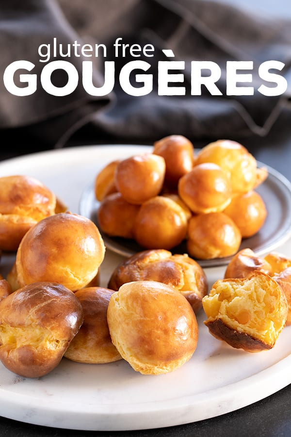 There are just 5 basic ingredients in these simple but fancy little cheese puffs with the funny French name, gougères. They'll never know they're gluten free unless you tell! #glutenfree #gf #frenchpastry #gougeres #cheese #bread