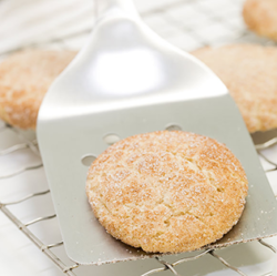 snickerdoodle cookie on spatula resting on wire rack