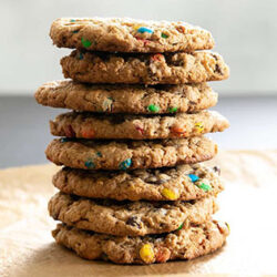 stack of 8 chocolate chip monster cookies on brown paper