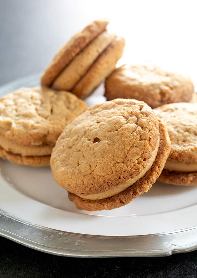 These crispy but tender peanut butter oatmeal cookies with a sweet, creamy peanut butter filling taste just like Do-Si-Dos Girl Scout Cookies—but they're gluten free. Some matters you just have to take into your own hands!