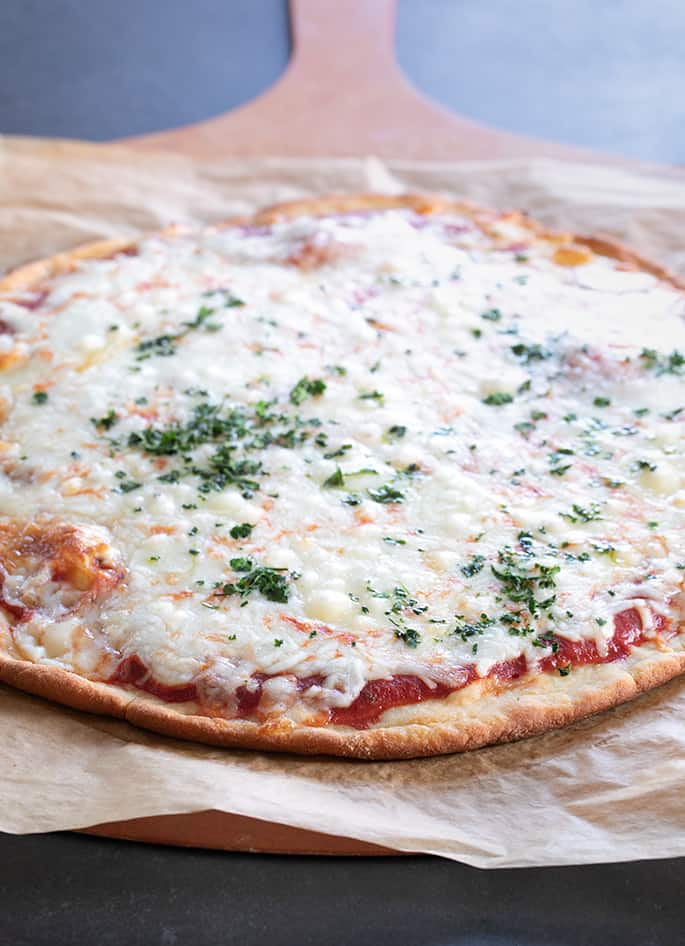 """This keto pizza recipe is the perfect easy way to add some low carb eating to your life. It even has that perfect thin crust pizza """"chew."""""""