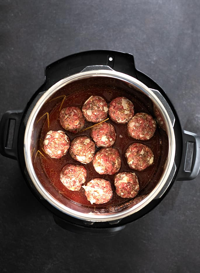 Once you learn to make these tender, flavorful gluten free meatballs and perfectly cooked gf spaghetti in the Instant Pot, you'll never want to make them any other way.