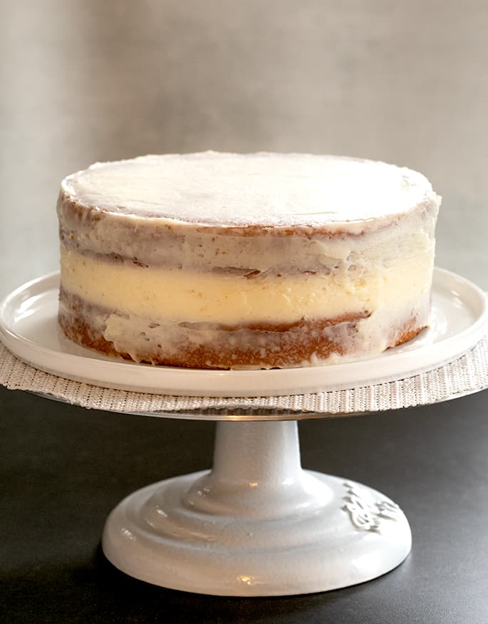 This bakery-style gluten free white cake, made without any egg yolks, is the perfect moist and tender blank canvas to dress up for any occasion.