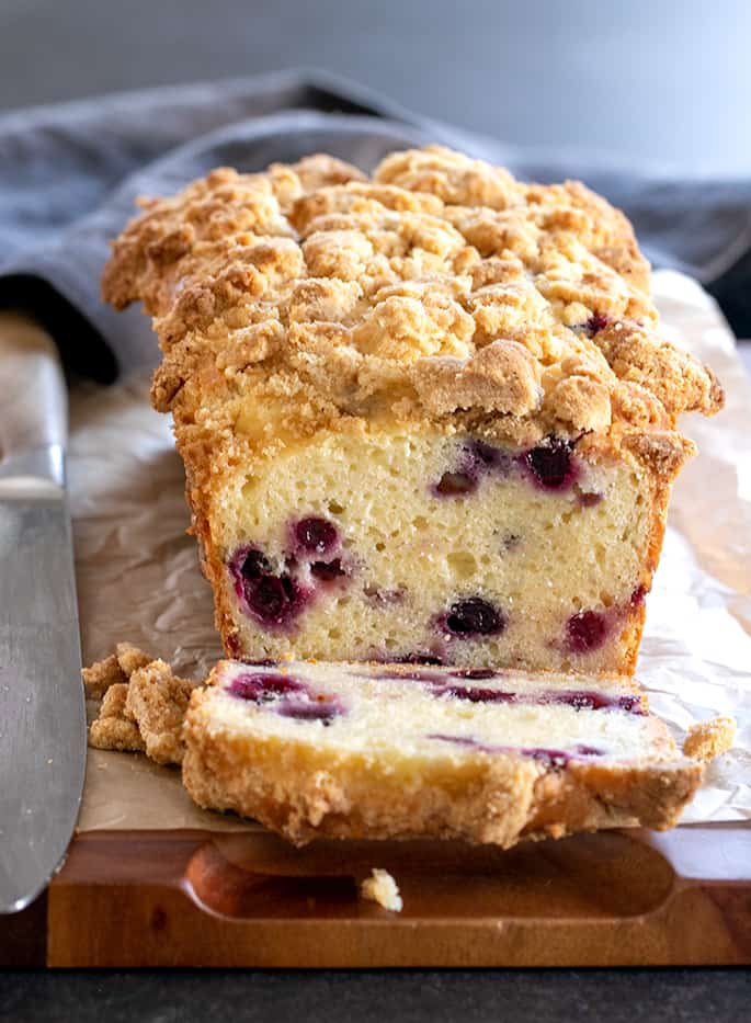 This gluten free blueberry muffin bread is a tender and rich quick bread made with sour cream, packed with fresh blueberries. Crumble topping (sort of) optional.