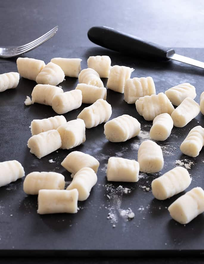Soft, tender and delicate dumplings, gluten free potato gnocchi make for a hearty meal no matter how you serve them.