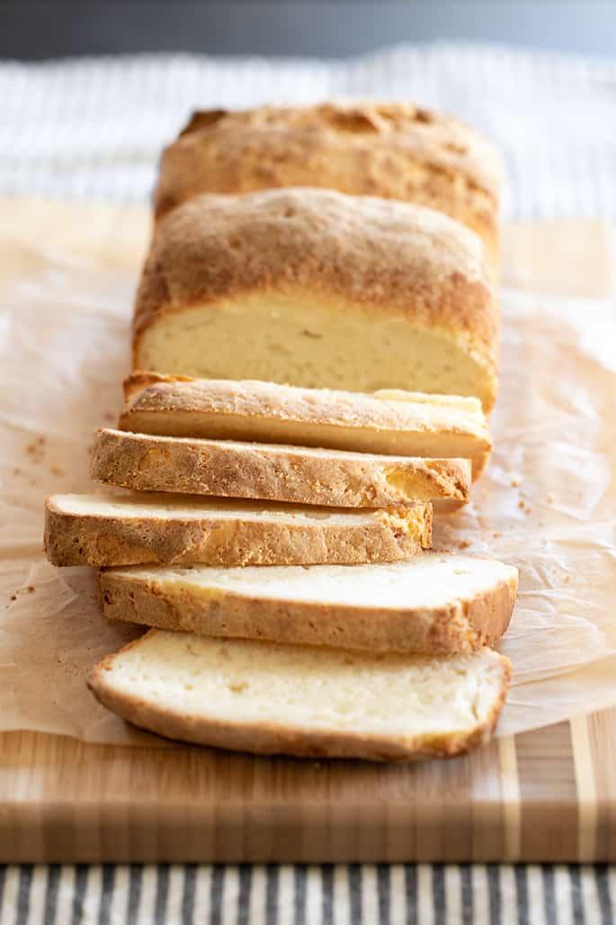 A loaf of sandwich bread half sliced