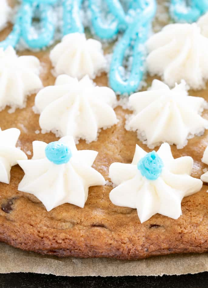 Let's make a big gluten free cookie cake, with chocolate chips, the blue and white frosting and everything. It's a celebration!