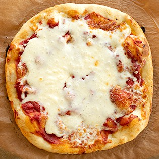 A basic recipe for gluten free pizza dough is one of the single most important staples to have in your kitchen. It's super simple to make, freezes well, and defrosts easily.