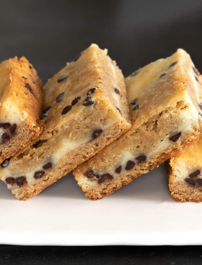 A stack of cheesecake blondies pictured from the side