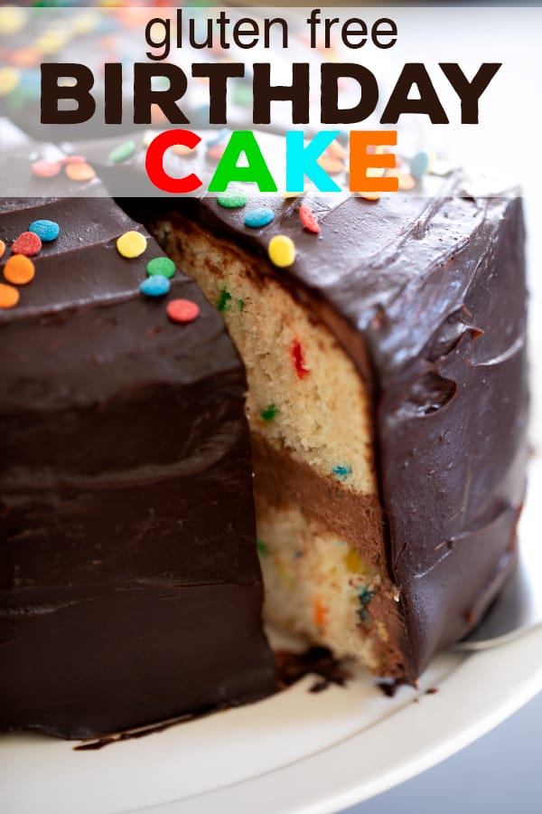 This classic gluten free birthday cake is a funfetti vanilla layer cake filled with chocolate sour cream frosting and topped with chocolate icing. It's your new go-to birthday cake. #glutenfree #gf #cake #funfetti #birthday