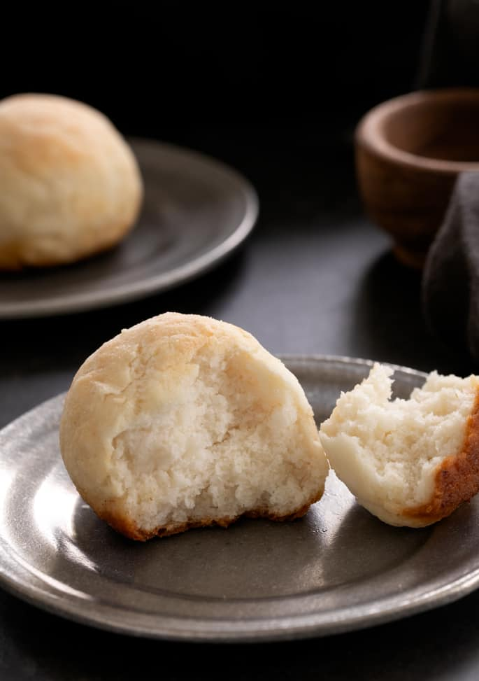 These super soft yeast free gluten free dinner rolls are ready for baking in the oven in 10 minutes. Never buy rolls again!