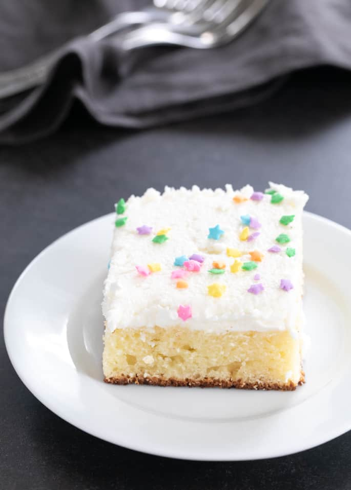 This classic gluten free vanilla sheet cake is the (nearly) one bowl, super simple vanilla cake that's perfect for any celebration, but doesn't look like you went overboard.