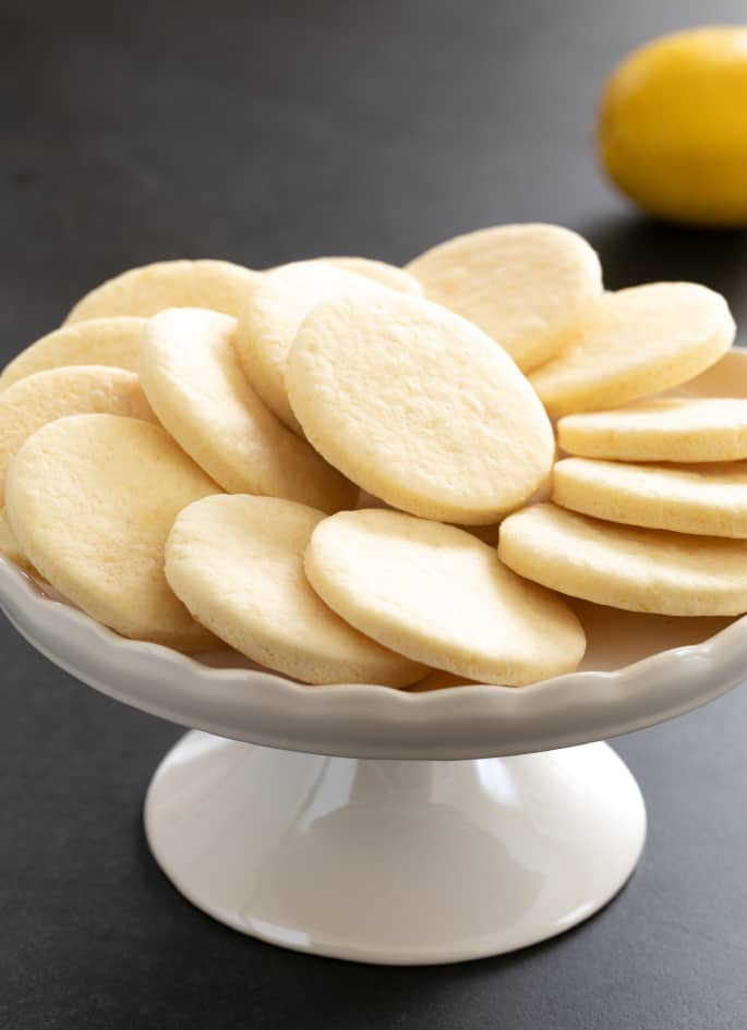 These soft, chewy cutout gluten free lemon sugar cookies are just like Lofthouse cookies, but with a simple lemon icing and just enough bright, citrus flavor.