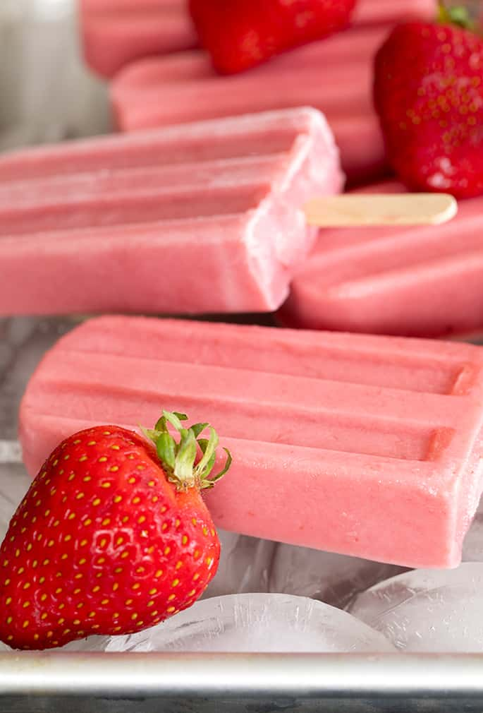 Smooth and creamy, naturally gluten free strawberry yogurt popsicles are perfect for a refreshing breakfast on the go, or an afternoon snack. Make them with fresh or frozen berries.