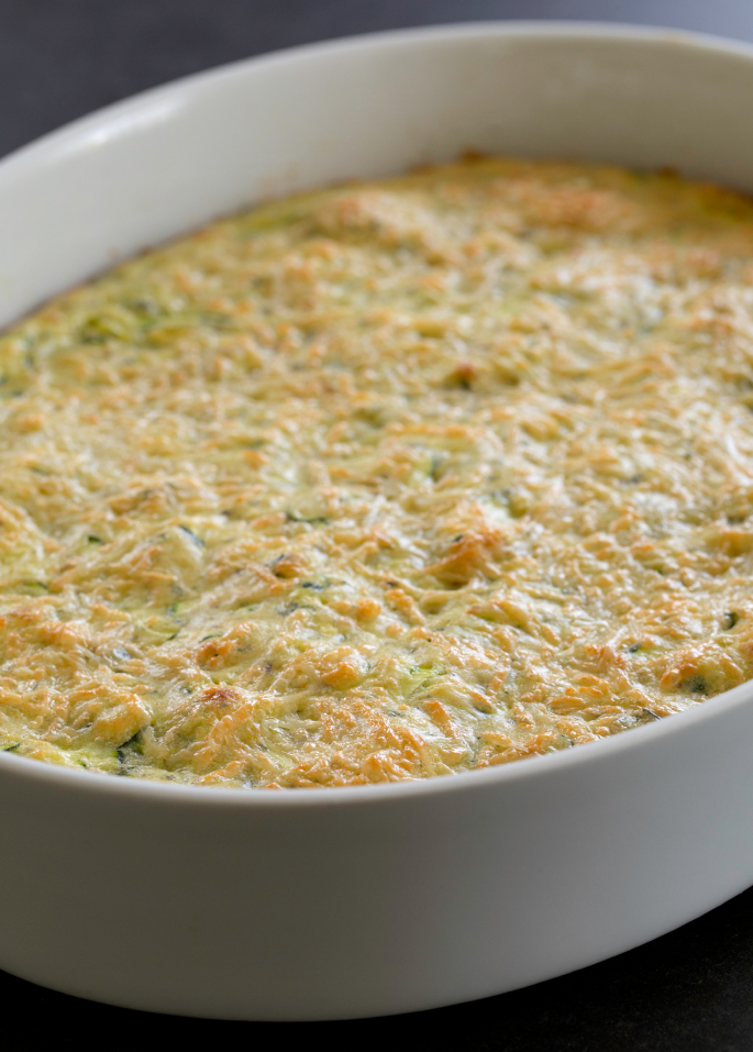 Make good use of that abundant summer squash in this easy recipe for savory gluten free zucchini parmesan squares. Perfect for a picnic lunch or a snack!
