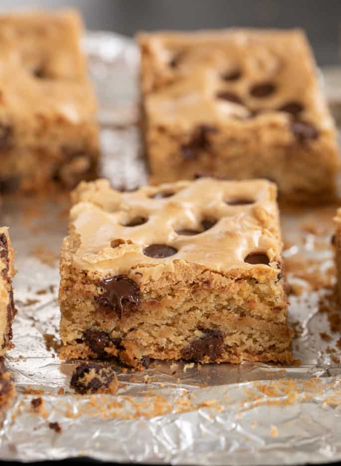 These thick and chewy gluten free chocolate chip cookie bars are the easiest way to bake up everyone's favorite chocolate chip cookies in a single square baking pan.