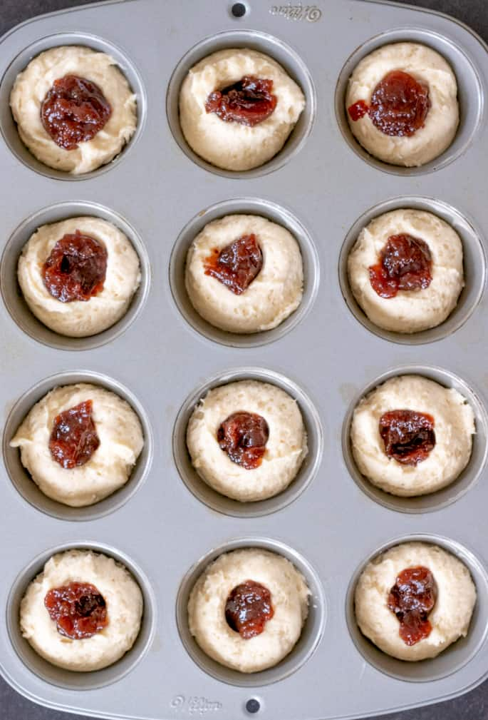 These extra tender gluten free donut muffins with jam filling taste like an old-fashioned cake donut, but they're baked easily in a muffin tin.