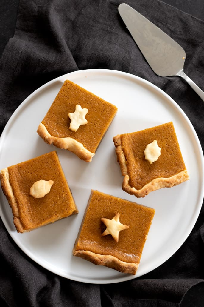 Gluten free pumpkin slab pie overhead image of slices on a platter.