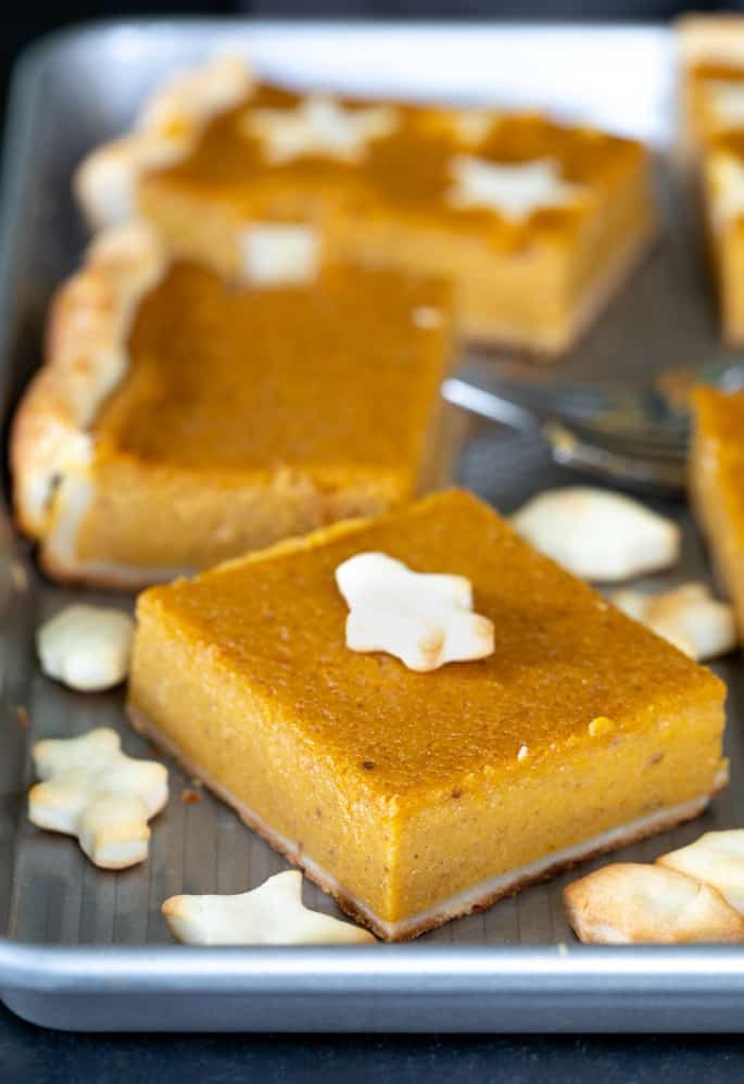 A piece of gluten free pumpkin slab pie closeup.