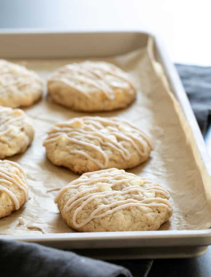 Gluten free apple pie cookies baked on tray and drizzled with icing