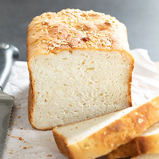 Gluten free white sandwich bread with seeds shown sliced, square image for homepage